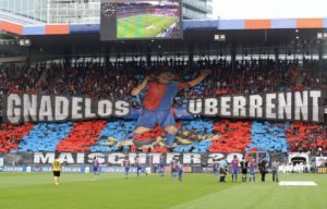 "Fans of FC Basel (FCB) display a giant banner before a Swiss Super League soccer match against BSC Young Boys (YB) in Basel May 23, 2012. The slogan is reading: ""Overrun without pardon"". REUTERS/Arnd Wiegmann (SWITZERLAND - Tags: SPORT SOCCER)"